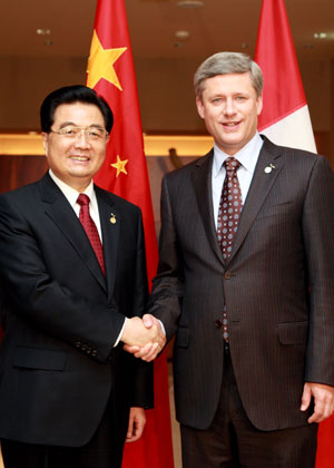 Chinese President Hu Jintao and Canadian PM Stephen Harper