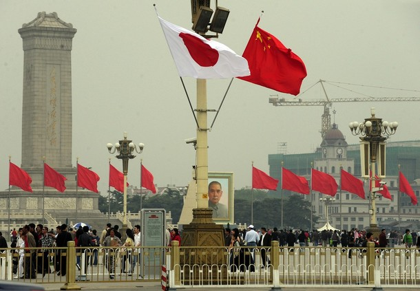 Chinese and Japanese flags over Tiananmen Square 2009. (Photo: Getty Images)