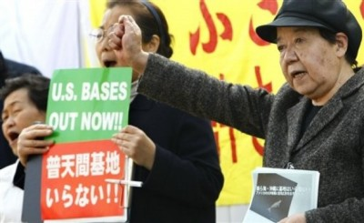 Anti-base protestors outside the Japanese Diet (picture: AP images).