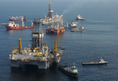 From foreground, the mobile offshore drilling unit (MODU) Development Driller II prepares to drill a relief well at the site of the Deepwater Horizon oil spill, on May 18, 2010. (Photo: US Department of Defense)