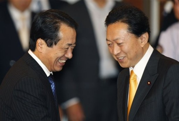 Japanese Prime Minister-elect Naoto Kan, left, chats with his predecessor Yukio Hatoyama before a general meeting of their Democratic Party of Japan (DPJ) in Tokyo on June 7, 2010. (Photo: AP Photo/Shizuo Kambayashi)