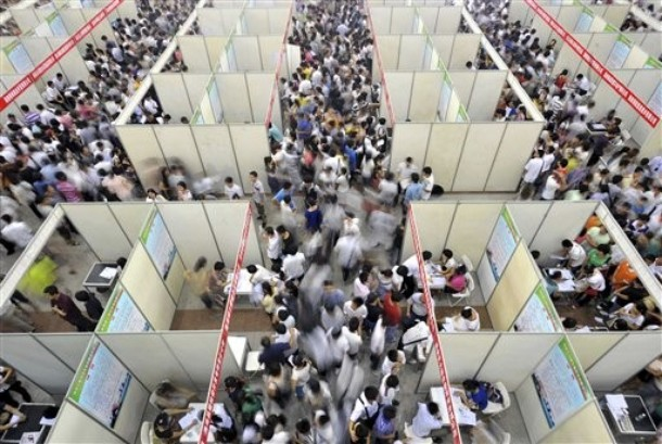 In this Tuesday, July 13, 2010 photo released by China's Xinhua News Agency, college graduates attend a job fair in Haikou, capital of south China's Hainan Province. (Photo: Xinhua/Guo Cheng)