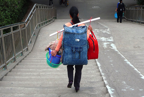 A heavy loaded migrant worker starts the journey home for Chinese New Year, in Shenzhen on February 4, 2010. (Photo: Flickr user 'dcmaster')