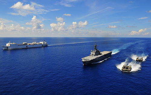 The Military Sealift Command hospital ship USNS Mercy (T-AH 19), left, the Japan Maritime Self-Defense Force Osumi-class amphibious assault ship JDS Kunisaki (LST 4003), center, and two landing craft air cushions assigned to Kunisaki transit through the South China Sea to Cambodia. (Photo: US Navy/Jon Husman)