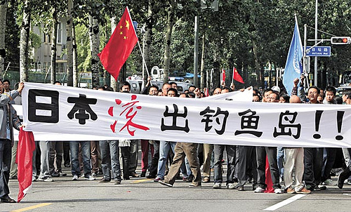 Protesters carries a banner that reads 'Japan get out of Diaoyu Island' and chant slogans during an anti-Japan protest outside the Japanese Embassy in Beijing, on September 18, 2010. (Photo: AP Photo/Andy Wong)