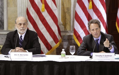 US Treasury Secretary Tim Geithner (R) speaks next to Federal Reserve Board Chairman Ben Bernanke at the Financial Stability Oversight Council meeting at the Department of the Treasury in Washington, DC on October 1, 2010. (Photo: AFP/Yuri Gripas)