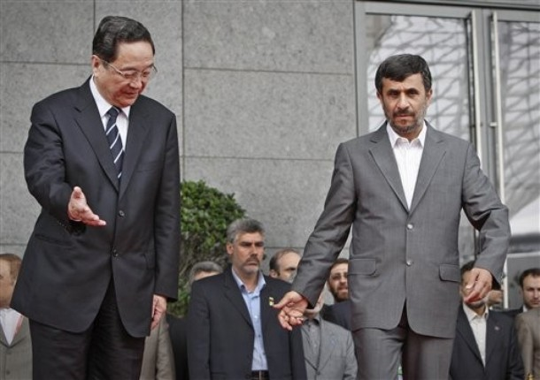 Iranian President Mahmoud Ahmadinejad, right, is shown the way by Chinese official Yu Zhengsheng after a flag raising ceremony during his visit to the Shanghai World Expo in Shanghai, China on June 11, 2010. (Photo: AP Photo/Andy Wong)