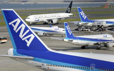 All Nippon Airways (ANA) jetliners stand at the Haneda airport in Tokyo on April 30, 2010. (Photo: AFP Photo/Toshifumi Kitamura)