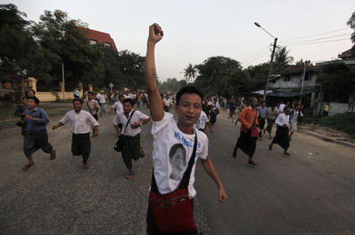 Supporters of Myanmar's pro democracy leader Aung San Suu Kyi run towards her home in celebration of her release from house arrest in Yangon, Myanmar on November 13, 2010. (Photo: AP Photo)