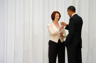 United States President Barack Obama (R) shares a fist bump with Australian Prime Minister Julia Gillard prior to the during the Leaders' Declaration of the Asia-Pacific Economic Cooperation (APEC) Leaders Meeting in Yokohama, Japan, 14 November 2010.