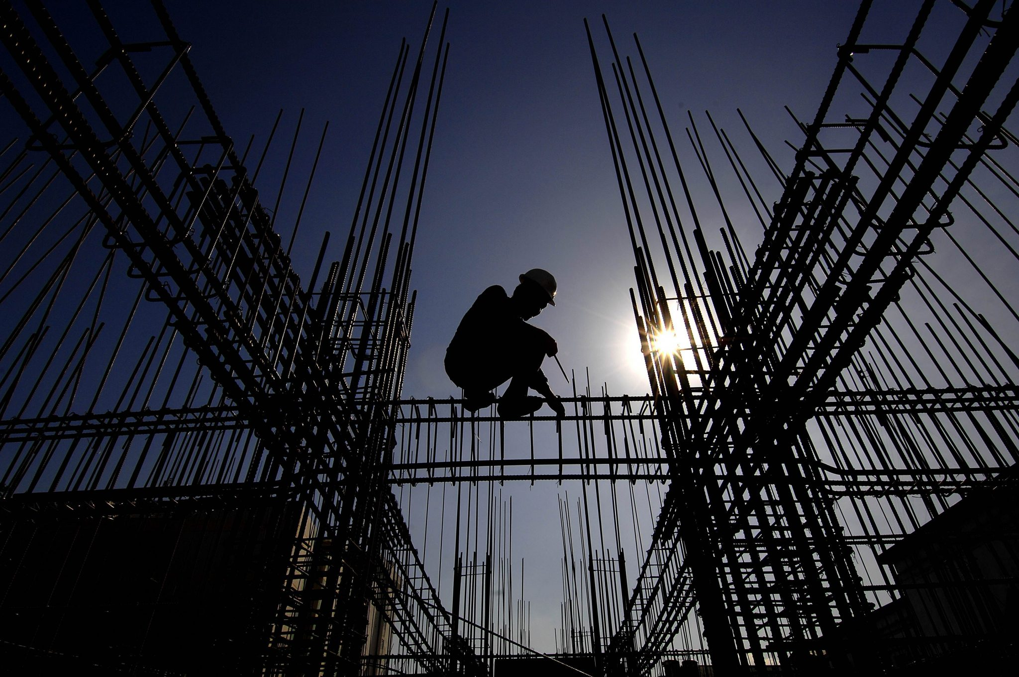 A construction worker prepares steel reinforcment bars of an unfinished building in Manila on April 16, 2010.  The Philippines will avoid recession and post growth of at least 0.8 percent this year, despite the effects of the global economic slump and a series of killer storms, the government said recently. (Photo: AAP)