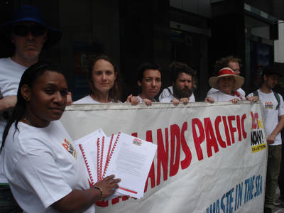 Iona Reto (left) protests outside the Brisbane offices of Highlands Pacific, Thursday, Nov. 25, 2010. Ms Reto attempted to deliver a petition from PNG landholders opposed to a plan to dump mine at sea near Madang. (Photo: AAP)