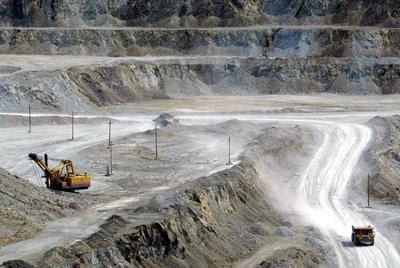 Trucks carry copper ore from a quarry at a state-owned mine in Erdenet, Mongolia. The copper mine is one of the ten largest in the world. All of the copper produced here is exported to China. (Photo: AAP)