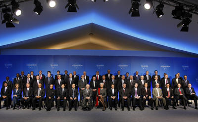Finance ministers and central bank governors pose for a group photo during the G20 Finance meeting in Paris, 19 February 2011. (Photo: AAP)