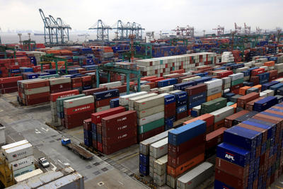 Piles of containers at Waigaoqiao Container Port are seen March 3, 2009 in Shanghai, China. (Photo: AAP)