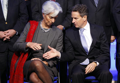 French Finance Minister Christine Lagarde, left, shakes hands with US Treasury Secretary Timothy Geithner during the family picture of the G20 Finance summit at Bercy Finance Ministry in Paris on 19 February 2011. (Photo: AAP)