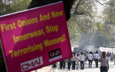 A placard is displayed on a tree during a protest by garment retailers against the proposed mandatory 10 percent excise duty on branded garments in the recent federal budget in New Delhi, India, Tuesday, March 15, 2011. (Photo: AAP)