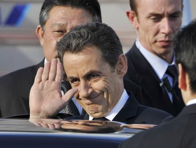 French President Nicolas Sarkozy gestures before boarding a car upon arrival at Haneda International Airport in Tokyo. Sarkozy arrived here to offer support to the country after its earthquake, tsunami and nuclear reactor crisis. (Photo: AAP)