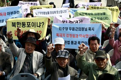 North Korean defectors demand the passing of North Korea peoples human rights laws from National Assembly at a protest earlier this month. Will South Korea have the resources to demand unification? (Photo: AAP)
