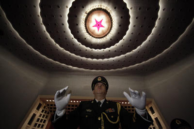A Chinese military band conductor rehearses on the final day of the National People's Congress at the Great Hall of the People in Beijing, China, Sunday, March 14, 2010. (Photo: AAP)