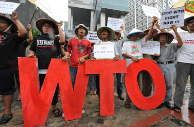 Protesters shout slogans during an anti-WTO protest in front of the trade ministry in Jakarta. (Photo: AAP)