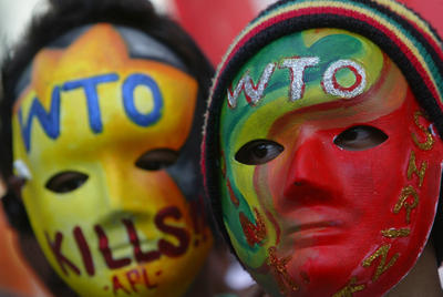 Filipino activists wear colorful masks during a rally against the economic liberalization policies pushed by the World Trade Organization at the Mendiola bridge, Manila, Philippines. (Photo: AAP)