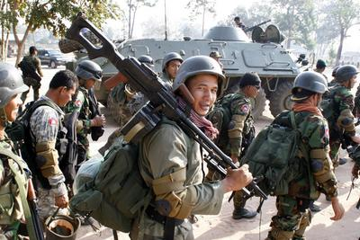 Cambodian soldiers walk at a military base as they prepare to go to Preah Vihear temple in Preah Vihear province, some 500 kilometers northwest of Phnom Penh on February 6, 2011. (Photo: AAP)