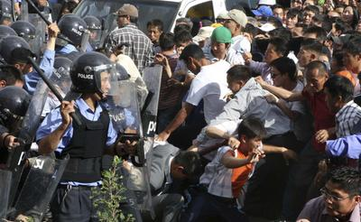 Mongolian policemen confront protestors in Ulaanbaatar. (Photo: AAP)