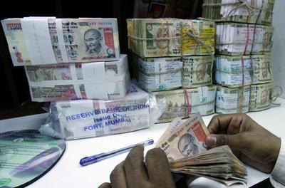 India's sliding rupee, sloppy policy