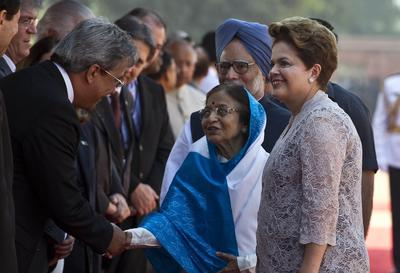 Brazilian President Dilma Rousseff introduces Brazilian delegates to Indian President Pratibha Devisingh Patil and Indian Prime Minister Manmohan Singh during a ceremonial reception in during the BRICS summit in New Delhi on 30 March 2012 (Photo: AAP).