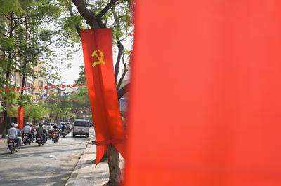 Hammer and sickle on banners along Vietnamese road. The protection of state-owned enterprises has been justified by the so-called socialist-oriented market economy. (Photo: AAP)