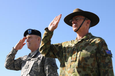 In this 17 January 2013 photo provided by US Army Pacific, US Army Maj. Gen. Roger Mathews and Australian Defence Forces Maj. Gen. Richard Burr salute during a ceremony welcoming Burr to Fort Shafter, Hawaii. The appointment of Burr to be deputy commanding general at US Army Pacific is the first time a non-American has served in such a high-ranking position at a command like this.  The move  symbolises the push of the Army to connect more with allies and friendly nations in the Pacific as the Obama administration rebalances national defence strategy toward the region.