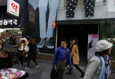 People walk through a shopping street in Seoul 12 April 2013.  South Koreans worry less than foreigners about the current North Korean belligerence. (Photo: AAP)