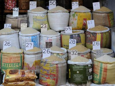 Various varieties of rice are displayed outside a shop in New Delhi on 15 April 2013. The proposed Indian Nation Food Security Bill will give two-thirds of India's population access to 5 kilograms of rice, wheat, and coarse cereals per month at heavily subsidised prices. (Photo: AAP)