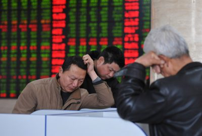 Investors in Fuyang watch the value of their assets ebb and flow as prices fluctuate on the stock market. It is reasonable to suggest that a simple lifecycle hypothesis determines saving: that consumption and savings behaviour is determined according to lifetime incomes. (Photo: AAP)