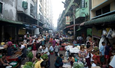 People walk across a market in Rangoon, Myanmar on 30 April 2012. (Photo: AAP)