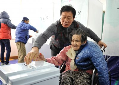 An elderly woman at Nonsan is helped to cast her vote in the South Korean presidential election in December 2012. South Korea is among those Asian countries whose populations are ageing most rapidly. (Photo: AAP)