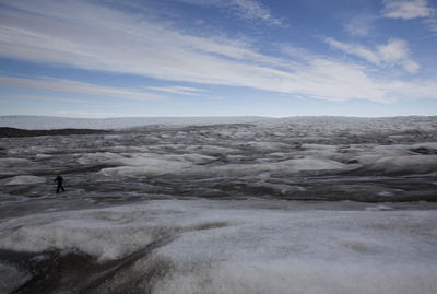 A woman hikes along the edge of the Greenland ice sheet, near Kangerlussuaq, Greenland. (Photo: AAP)