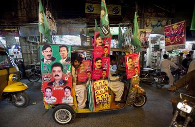A rickshaw is decorated with campaign posters for candidates in the upcoming election in Rawalpindi, Pakistan on Wednesday, 8 May 2013. Pakistan is scheduled to hold parliamentary elections on 11 May  2013. (Photo: AAP)