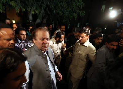 Former two-times Pakistani Prime Minister Nawaz Sharif, who heads the Pakistan Muslim League Nawaz political party that has won a majority in the parliament, talks with journalists after his meeting with Imran Khan. (Photo: AAP)