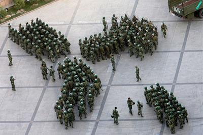 Chinese security forces assemble in Urumqi, Xinjiang, after riots in 2011. The US withdrawal from Afghanistan could lead to unrest in the far-western province (Photo: AAP).