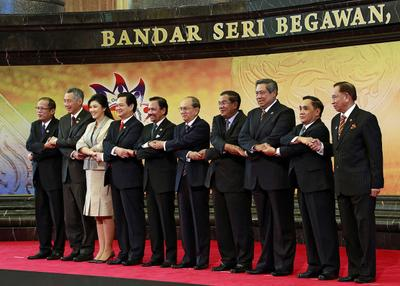 This handout photo taken by the Brunei Information Department on 25 April 2013 shows leaders from the 10-nation Association of Southeast Asian Nations (ASEAN) joining hands as they pose for a group photo at the summit in Bandar Seri Begawan. (Photo: AAP)