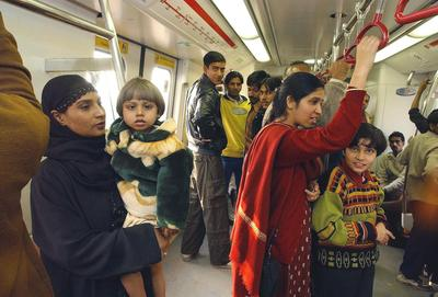 Passengers travel in a New Delhi metro train. The system was built using Japan