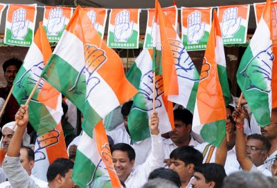 Party workers belonging to the Karnataka State Congress Committee (KPCC) celebrate their party