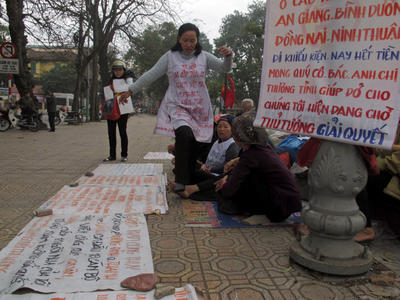 Vietnamese women protest the seizure of their land by the government on 31 January 2013 in Hanoi, Vietnam. (Photo: AAP)