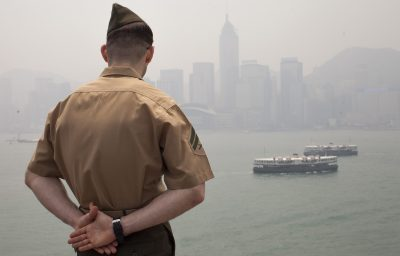A soldier on a visiting US Navy ship surveys the Hong Kong skyline. America will not be able to dominate Asia in the face of Chinese opposition. (Photo: AAP)