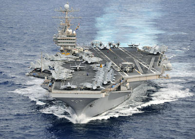 U.S. Navy aircraft carrier USS Abraham Lincoln (CVN 72) transits through the Pacific Ocean, December 2011. (Photo: AAP)