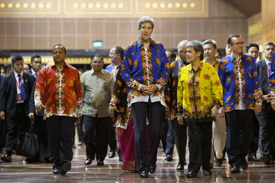 US Secretary of State John Kerry walks with Brunei Minister of Foreign Affairs and Trade Prince Mohamed Bolkiah, Australia