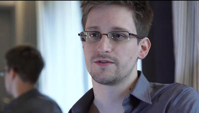 This photo shows Edward Snowden, who worked as a contract employee at the National Security Agency, on Sunday, 9 June  2013, in Hong Kong. NSA leaker Edward Snowden claims the spy agency gathers all communications into and out of the US for analysis, despite government claims that it only targets foreign traffic. (Photo: AAP)
