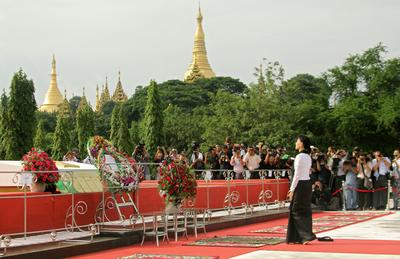 Aung San Suu Kyi pays her respects to her father General Aung San and eight other leaders, who were assassinated on July 19, 1947, as Myanmar marks the 66th anniversary of Martyrs Day at the Martyrs